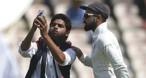 Another pitch invasion as fan breaches security to click selfie with Virat Kohli