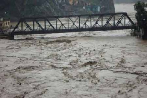Cloudburst flattens houses and a bridge in Uttarakhand