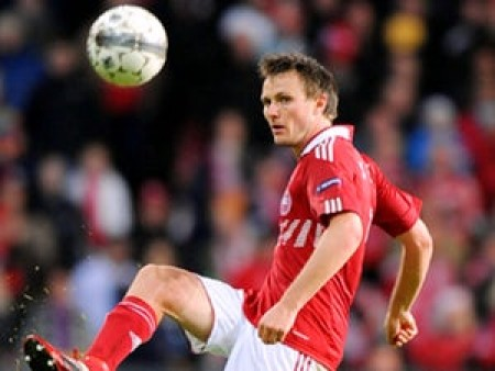 Danish midfielder Kvist out of World Cup with rib injury